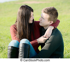 Young couple on the meadow