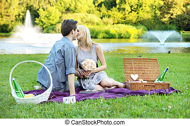 Young couple on the romantic date in the park