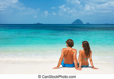 Young couple on the tropical beach - Young couple relaxing ...