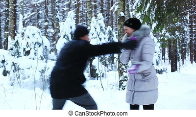 Young couple outdoors winter fun.