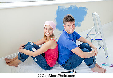 Young couple painting a room