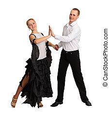 Young couple performs ballroom dance