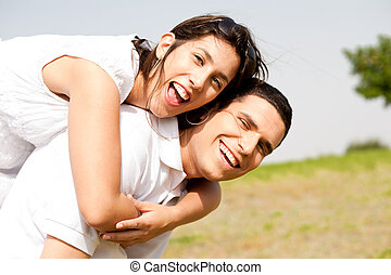 young Couple Piggybacking