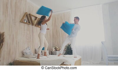 young couple pillow fight
