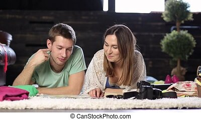 Young couple planning romantic adventure with map