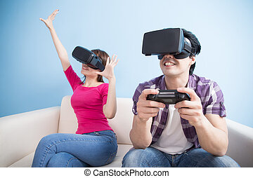 young couple play vr game