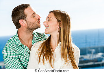 Young couple playing around. - Close up portrait of young ...