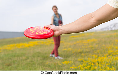 Young couple playing frisbee