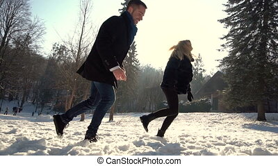 Young Couple Playing Snowballs