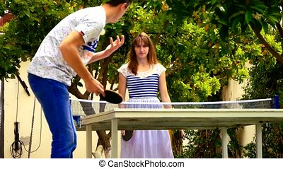 Young couple playing table tennis
