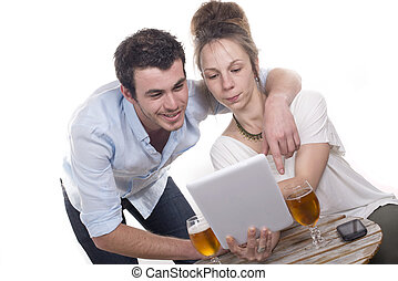 young couple playing with a digital tablet