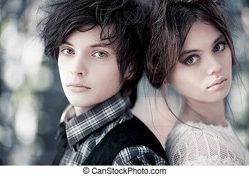 Young couple portrait. Focus on male face.