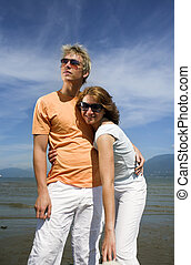 young couple posing on the beach in vancouver