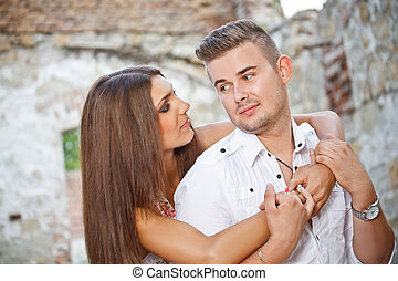 Young couple posing outdoors