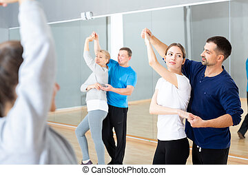 Young couple practicing active dance in pair - Young smiling...