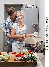 Young couple preparing food togethe