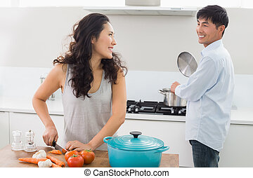 Young couple preparing food together