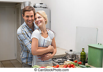 Young couple preparing food together in the kitchen