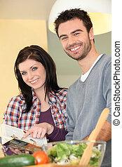 Young couple preparing healthy salad