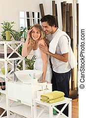 Young couple preparing in bathroom