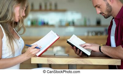 Young couple reading books on a date - Cute Couple Reads...