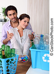 Young couple recycling