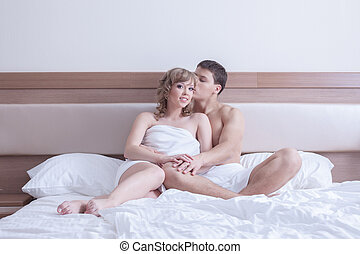 Young couple relax in bed at morning