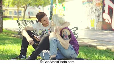 Young couple relaxing in an urban park