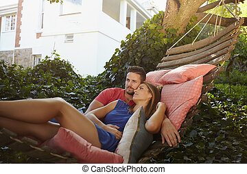 Young couple relaxing on a hammock