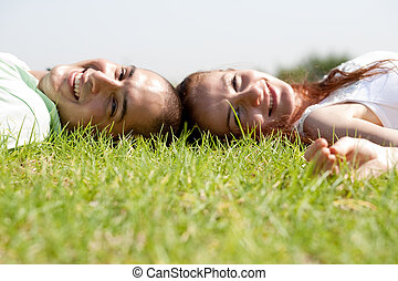 Young couple relaxing on a lawn
