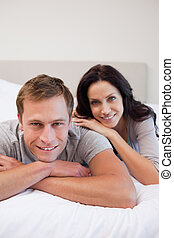 Young couple relaxing on the bed together