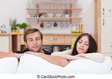 Young couple relaxing with closed eyes