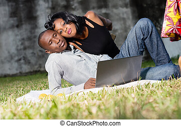young couple resting at the park