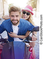 Young couple riding a scooter