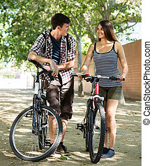 couple riding bikes in the park