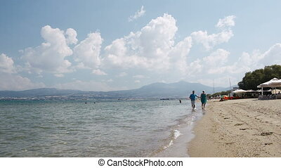 Young couple running along a beach