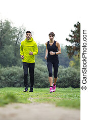 Young couple running in the park