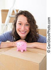 Young couple saving money in a piggy bank