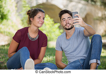young couple selfie in the park
