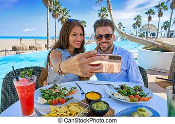 Young couple selfie smartphone photo