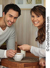 Young couple sharing a bowl of cornflakes
