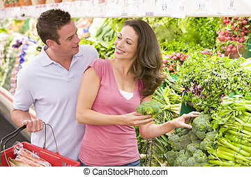 Young couple shopping for fresh produce