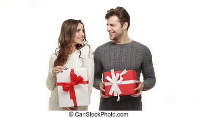 Young couple showing presents in Chrismas day on white...