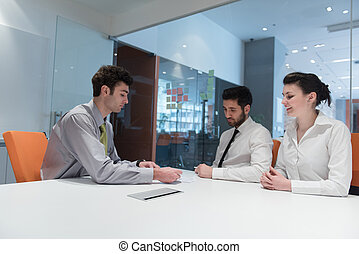 young couple signing contract documents on partners back
