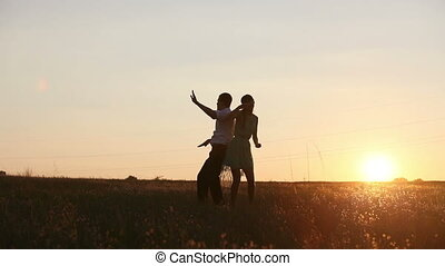 Young couple silhouettes dancing