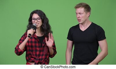 Young couple singing together