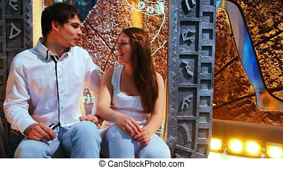 couple sits nicely talking on background of Egyptian scenery