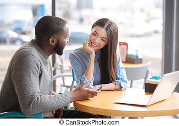 Young couple sitting at cafe