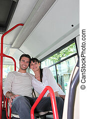 Young couple sitting in the bus
