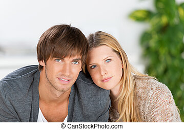young couple sitting nearby